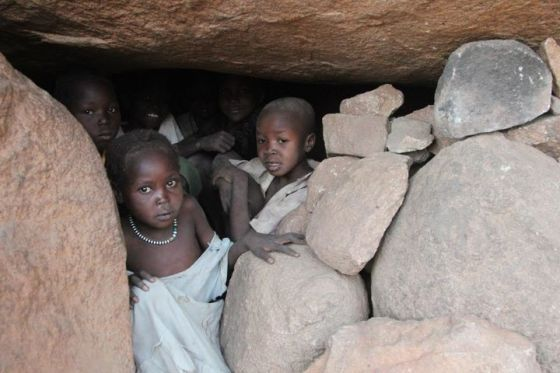 Women and children still hide in caves in Nuba Mountains when the bombs fall. Photo taken in 2012.